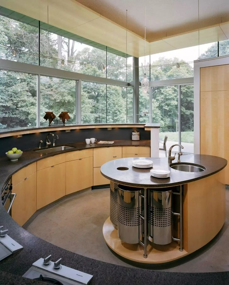 Unique oval forms design for the rich furnished private house kitchen