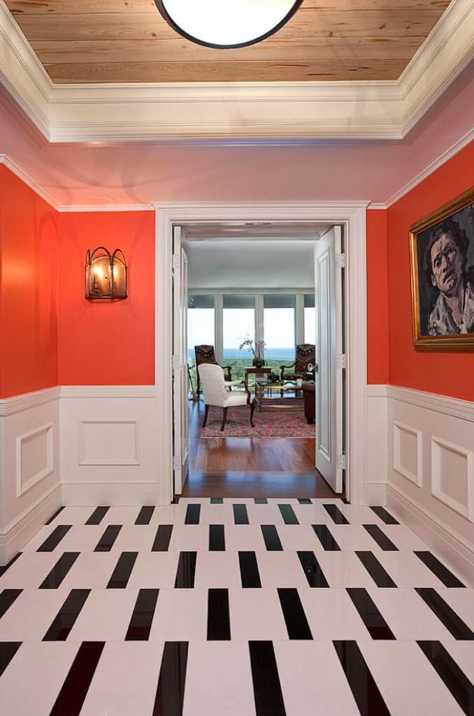 Choosing Floor Tiles for Entry and Hallway. Contrasting figures on the floor in the perky white-orange theme of the lobby