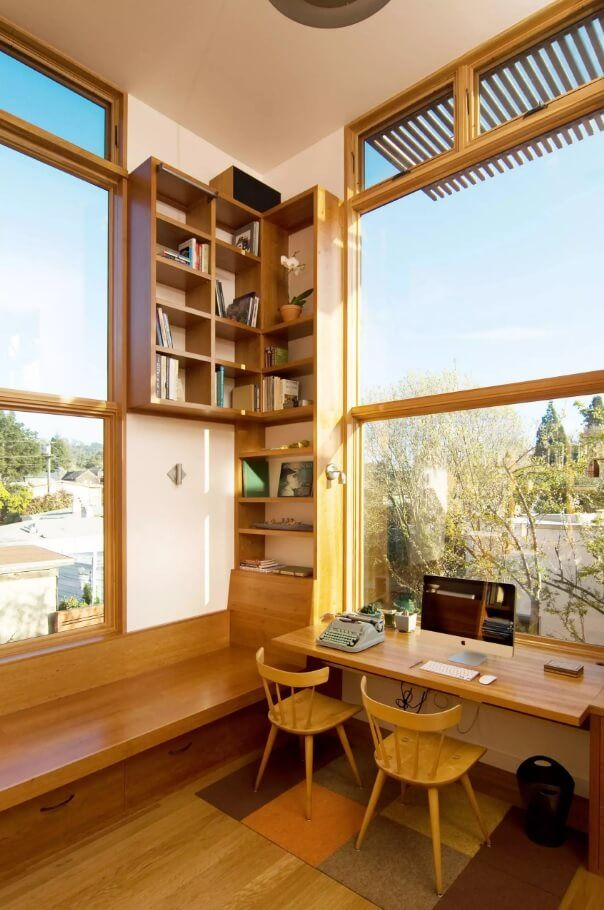 Wooden trimming of the unique home office with panoramic windows