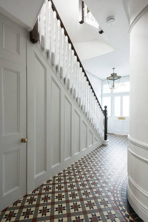 White wooden stairs and checkered tiled floor