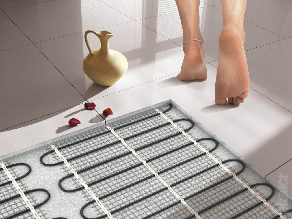 Electric warm floor view in the layer of ceramic tile (schematically)