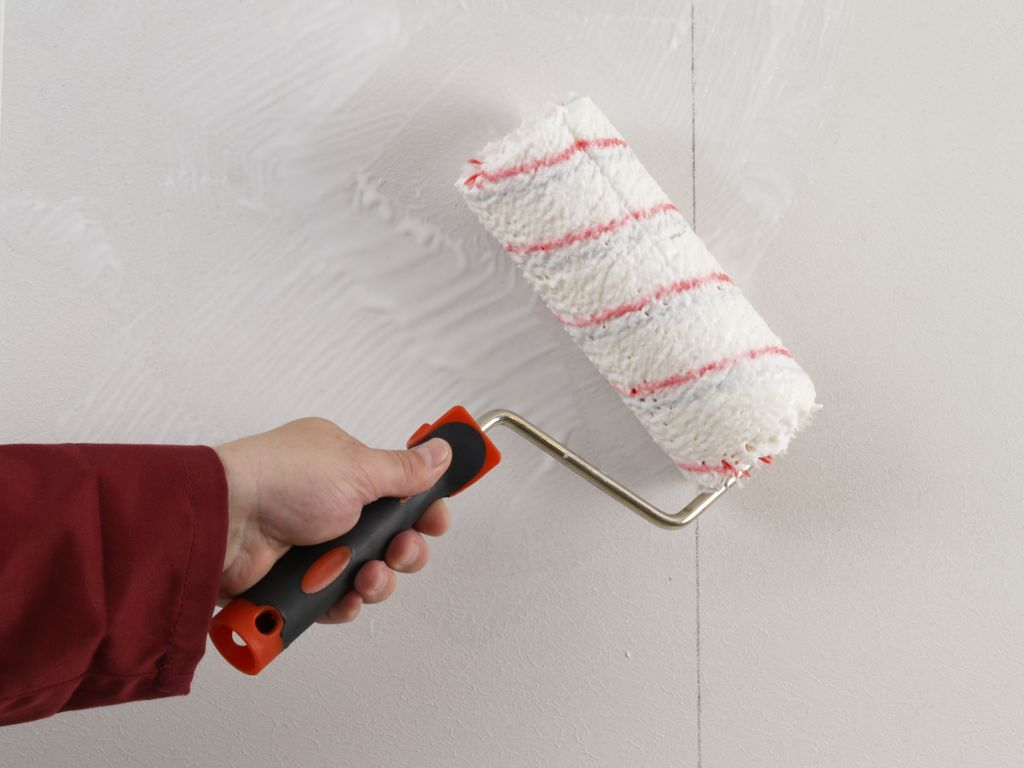 Applying the glue to the wall first
