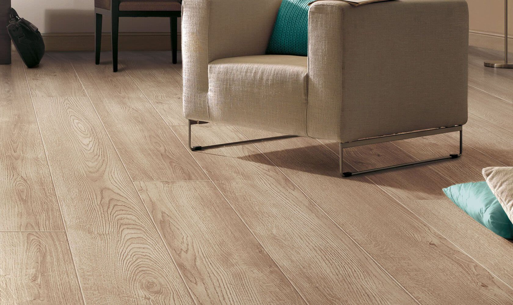 Laminate Floor Finishing Types, Description, Properties. The wooden texture of the material nicely blends with the armchair