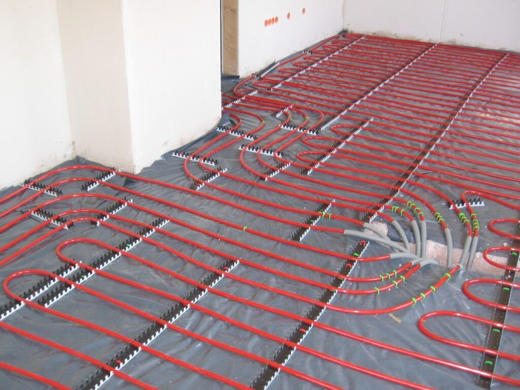 Warm Floor. Modern Technology for Comfort Home. Radiant floor is being built in the already used house