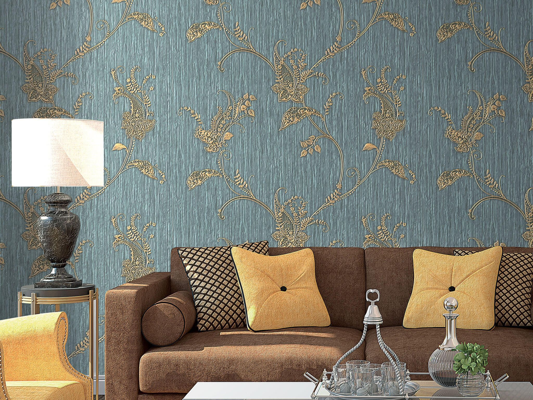 Living room sofa with colorful cushions at the background of the dark cyan wallpaper with gilded picture