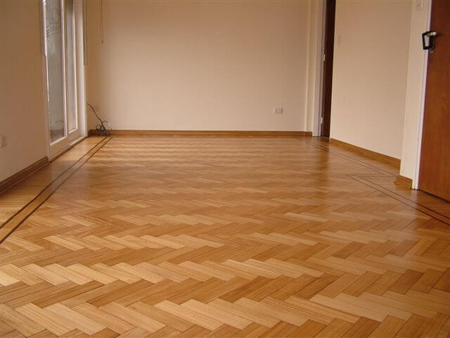 Parquet Flooring. Description, Review, Choosing Advice. Herringbone laying in the empty room