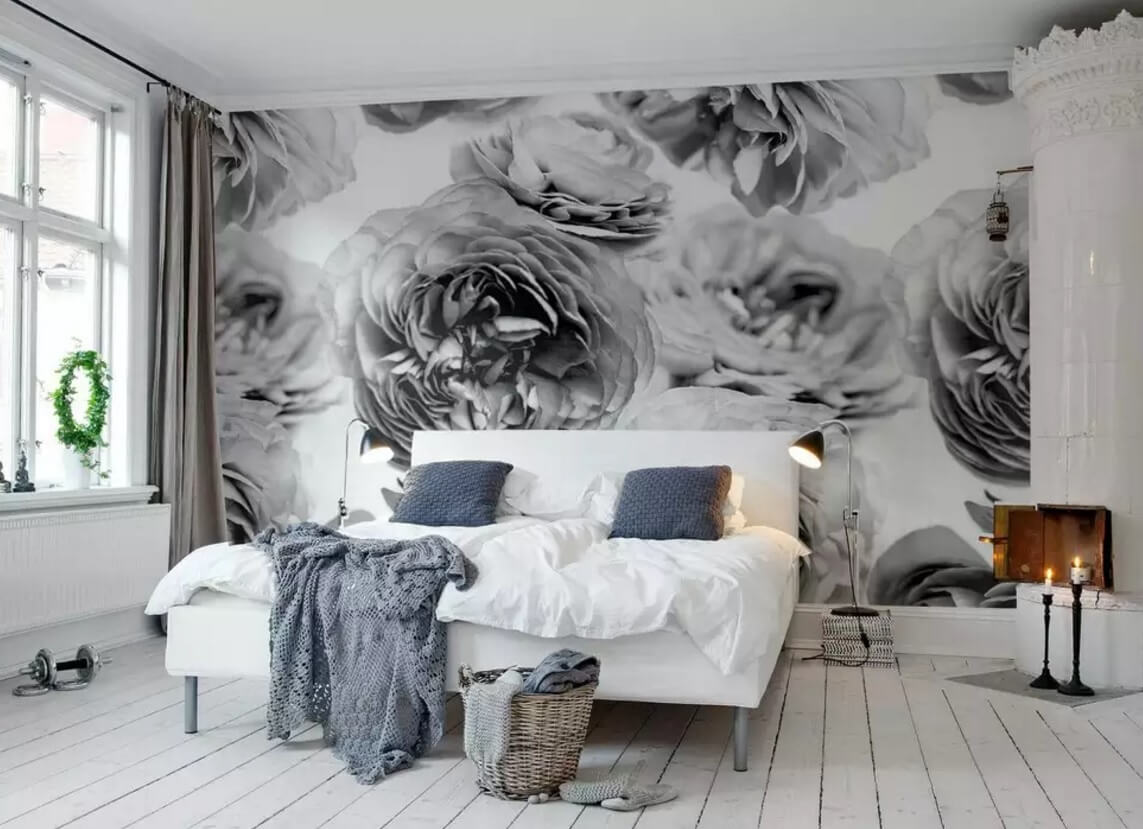 Black and white roses on the accent wall in the rustic styled bedroom