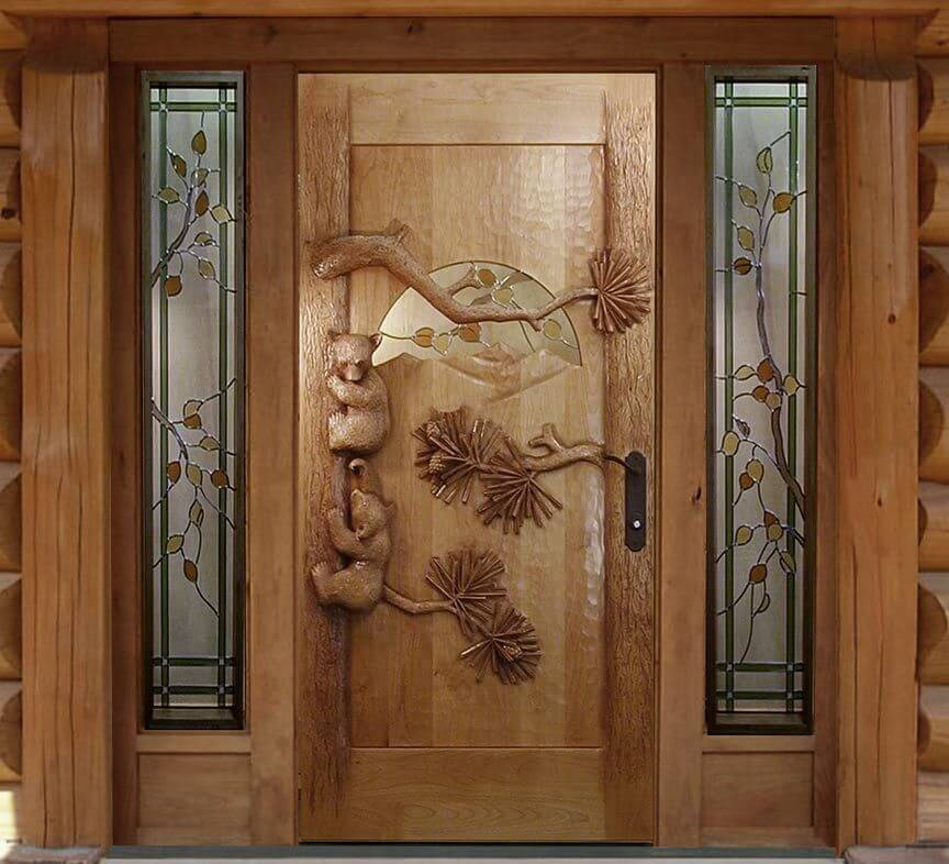 Carved Wooden Doors as Piece of Art in your Interior. Natural color of the entrance with peculiar carving on it