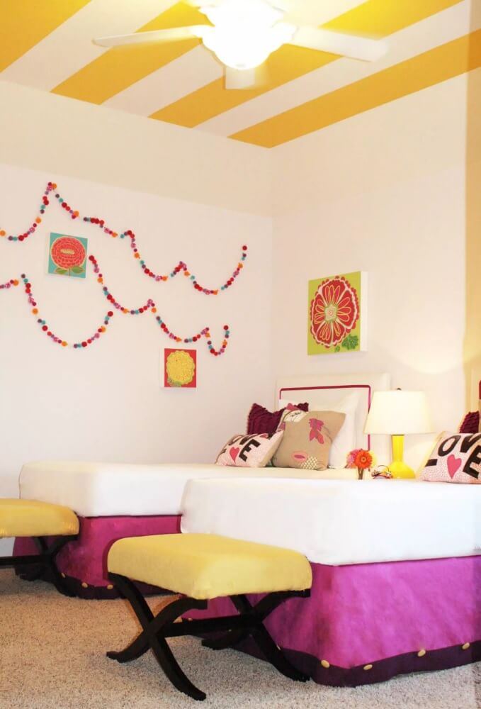 Striped yellow and white wall paint in the kids' room