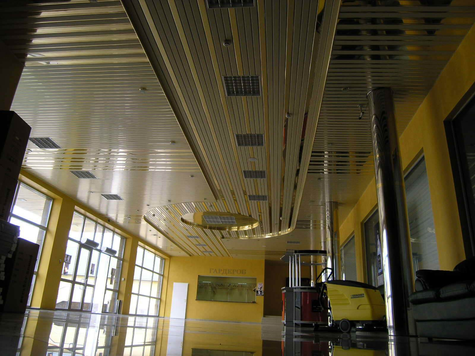 Aluminum Plank (Pinion) Ceiling Construction, Design, Installation. Combined construction in the large hall