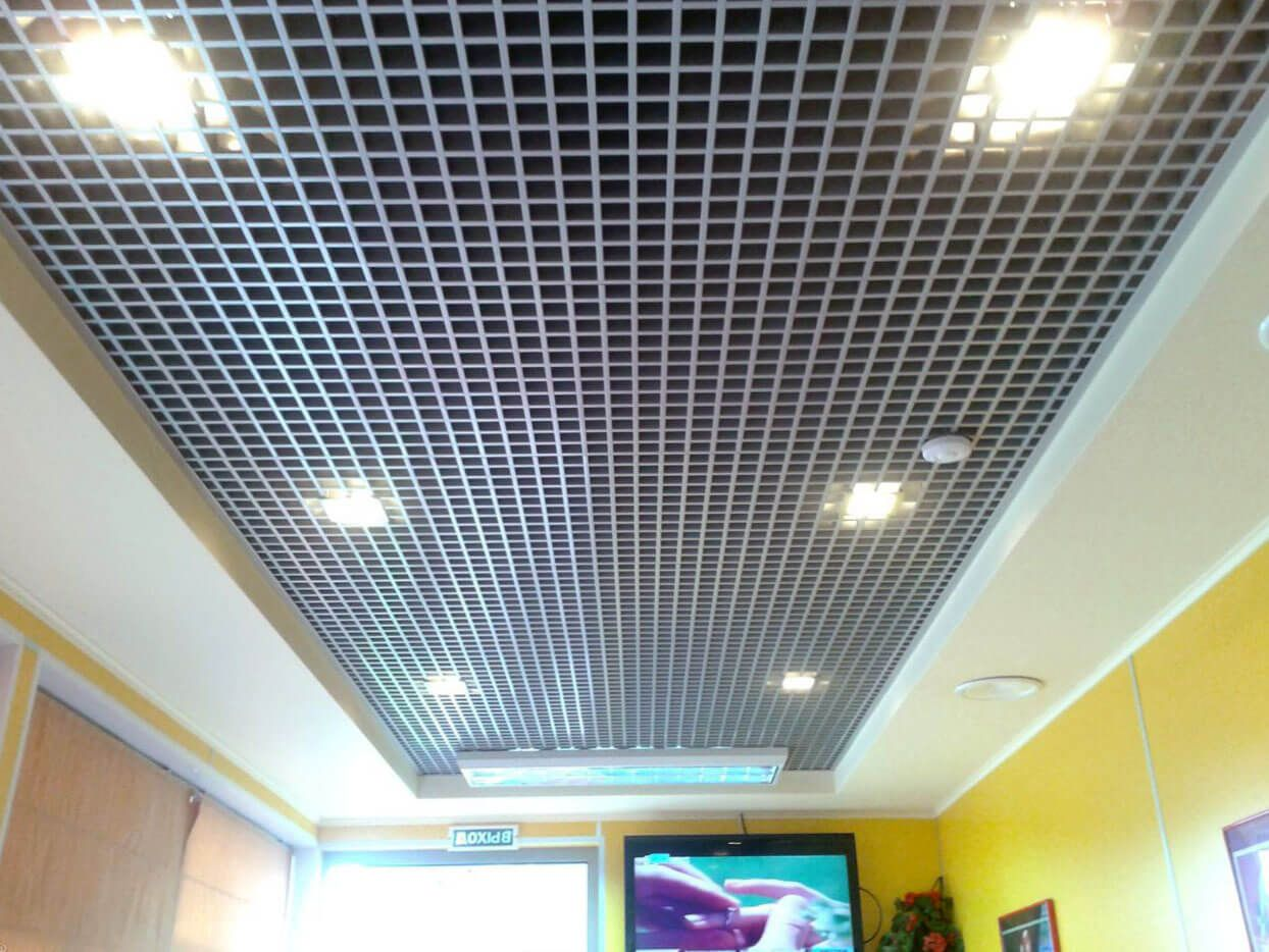 Section of aluminum lattice ceiling in the hall of the large apartment