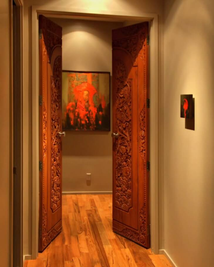 Carved Wooden Door as Piece of Art in your Interior. Interior door with fancy handmade picture