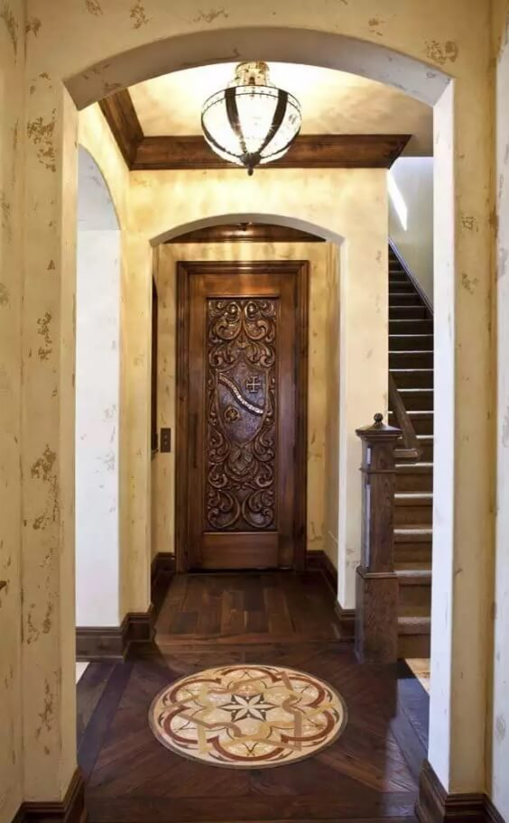 Carved Wooden Door as Piece of Art in your Interior. Noble classic interior with the stairs