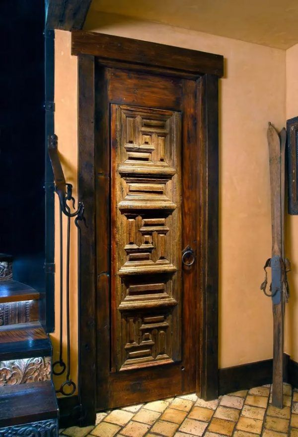 Peculiarly carved door in the rustic designed interior