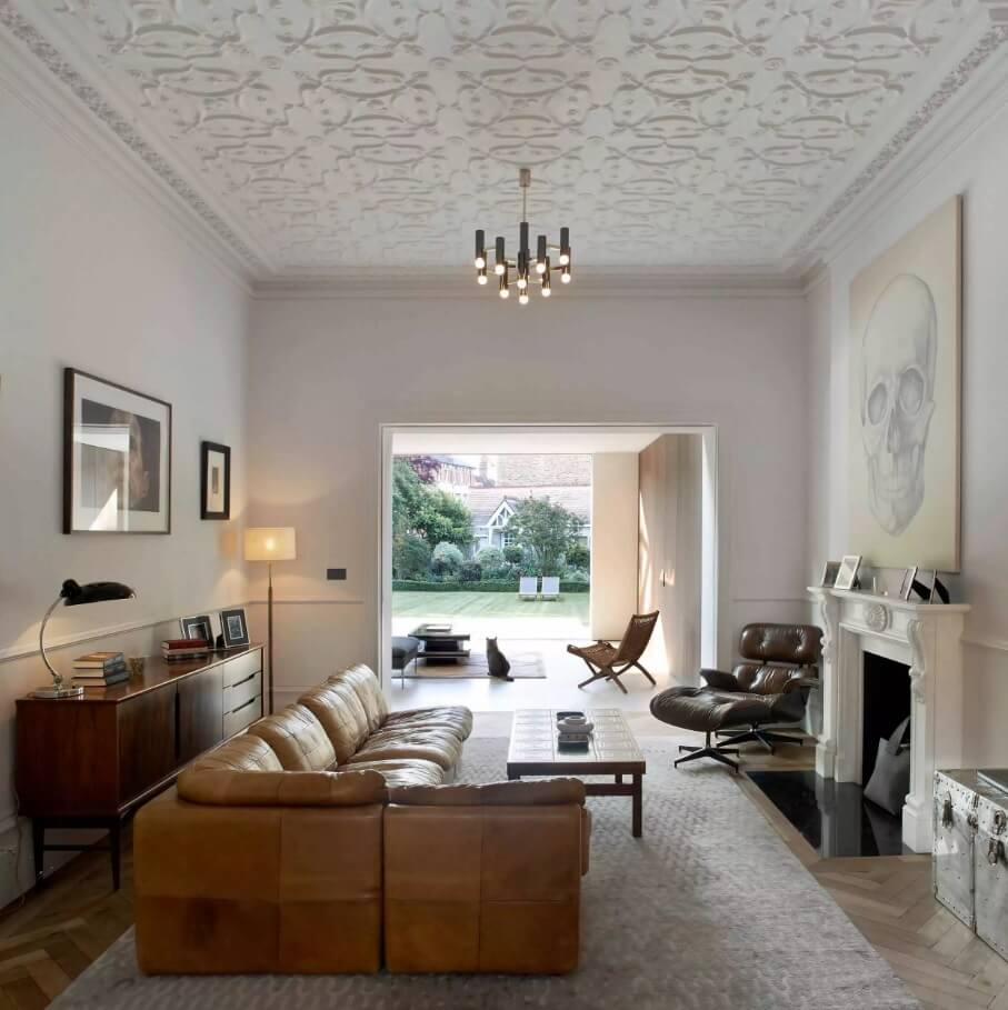 Brown leather corner sofa visually leads up to the entrance to the cottage