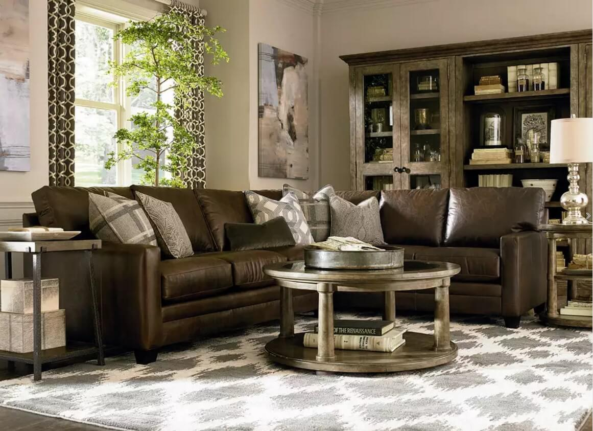 Dark noble leather sofa to emphasize the solidity of forms in the classic living room