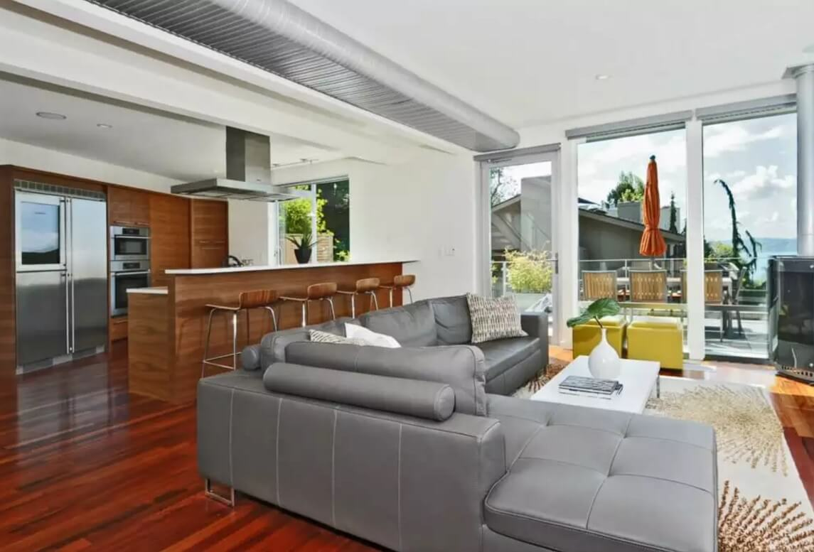 Leather Sectional Sofas to Complete your Living Room Image. Gray color and rounded backrests