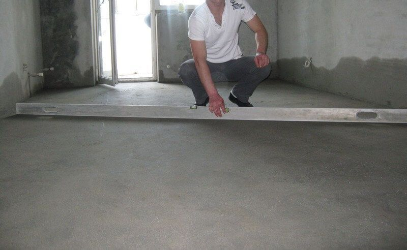 Long level to check the result of applying of the self-leveling floor