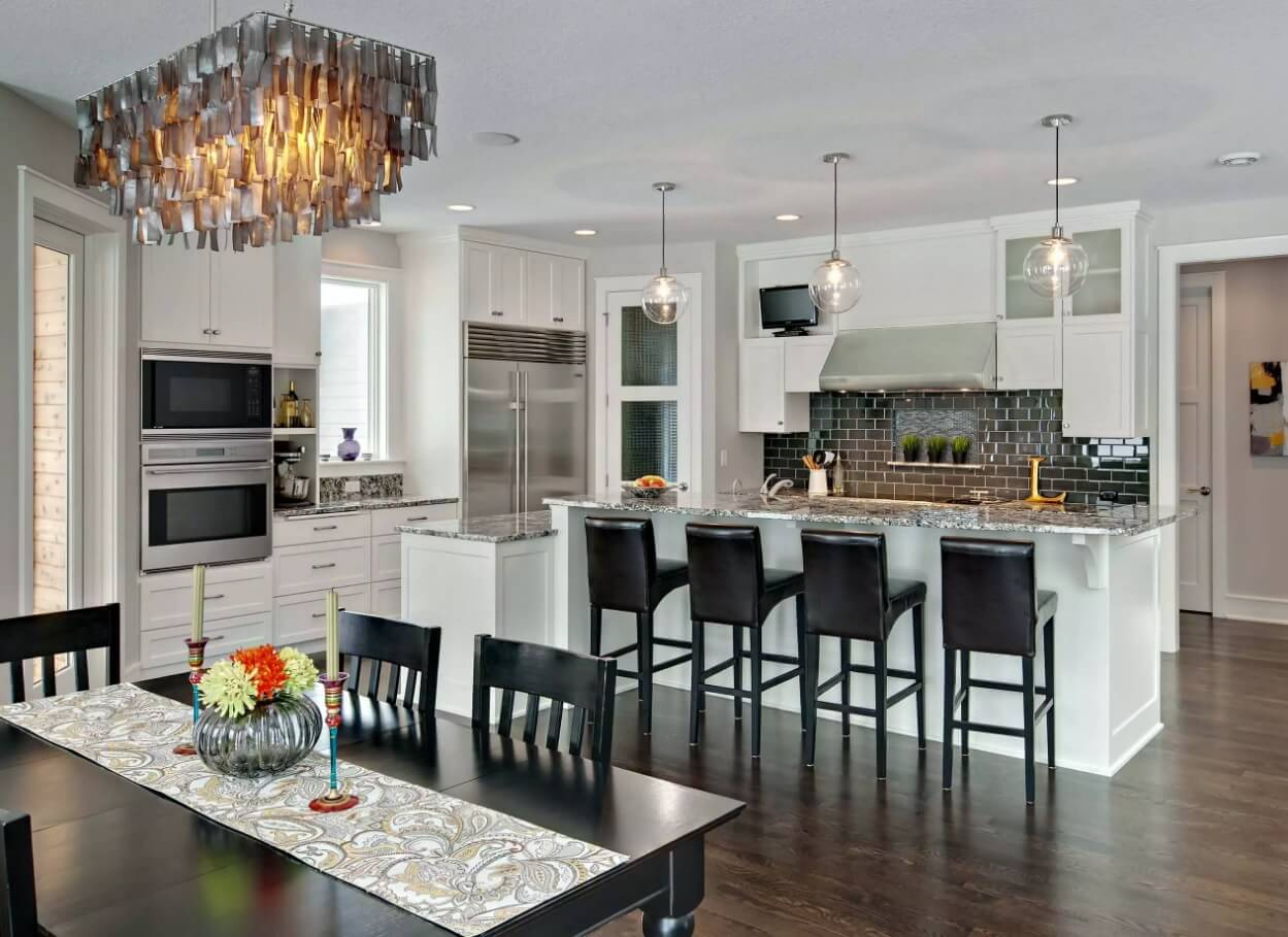 Kitchen Pendant Lighting Possible Design Types with Photos. Black chairs and glass fixtures