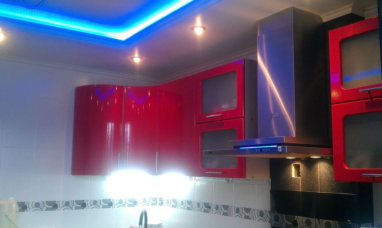 Plasterboard Ceiling Finishing Design Ideas for Apartment. Red kitchen facades harmonize with neon backlight of multileveled ceiling