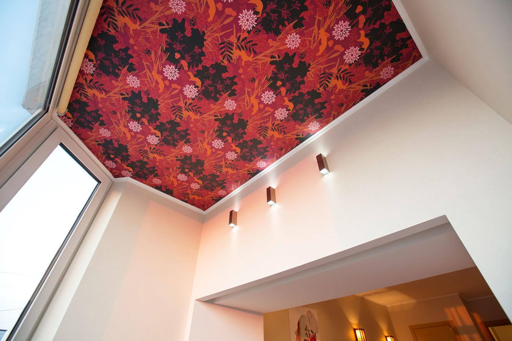 Bright red wallpaper at the balcone ceiling looks very fresh and intricately