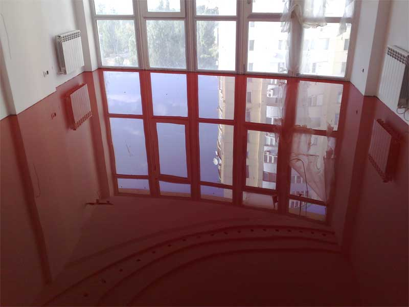 Spectacular look of the applied red liquid floor and the panoramic window