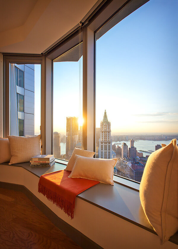 Window Sill Transformation into Uniquely Designed Cozy Additional Bed. Morning in New York waking at the panoramic bay window