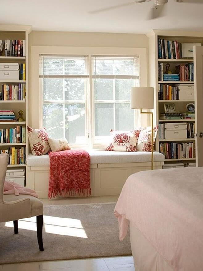Window Sill Transformation into Uniquely Designed Cozy Additional Bed. Classic American library with the sleeper between bookshelves