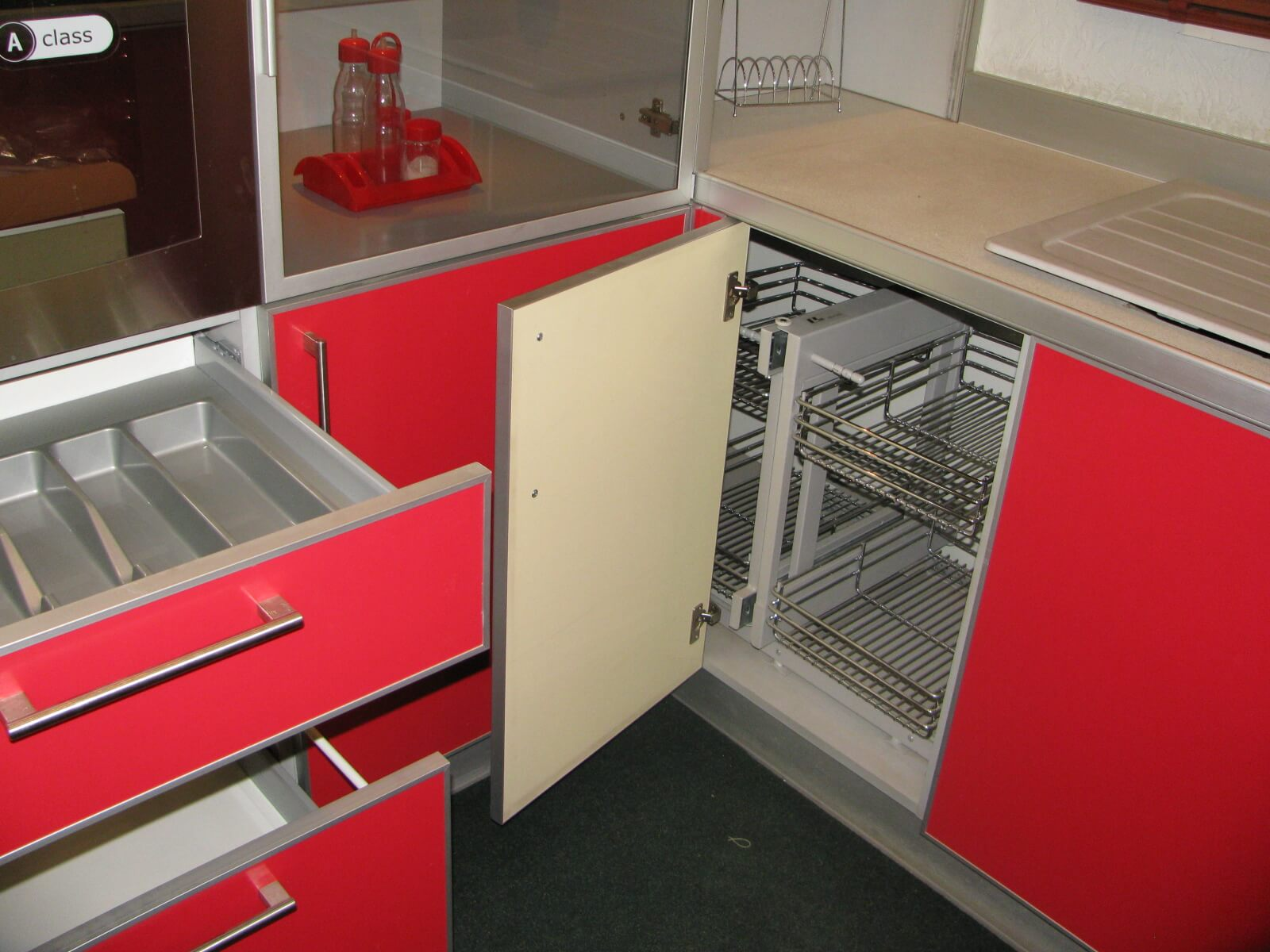 10 Kitchen Custom Custom Cabinets for Unique Functional Interior. Red plastic facades of the angle cabinet with multifunctional metal rack