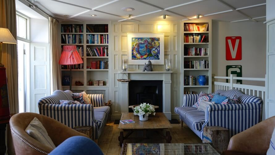 6 Things to Make Your Living Room Instantly Retro. Open shelves with books make your room a little more classic