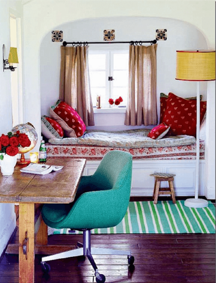 Small kids' room with turquoise notes in the decor and full-sized bed at the window sill