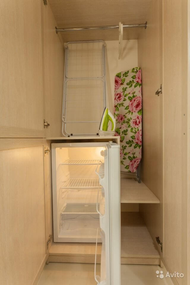 Tiny Russian Studio Apartment with Complicated Geometry Design Ideas. Small fridge built-in to the furniture storage composition