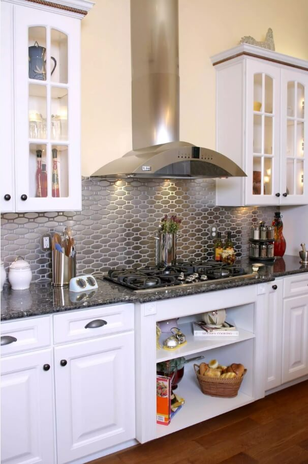 Metal Backsplash as Stylish Design Idea for Kitchen Interior. Absolutely gorgeous kitchen design complex with stainless shield with wavy pattern