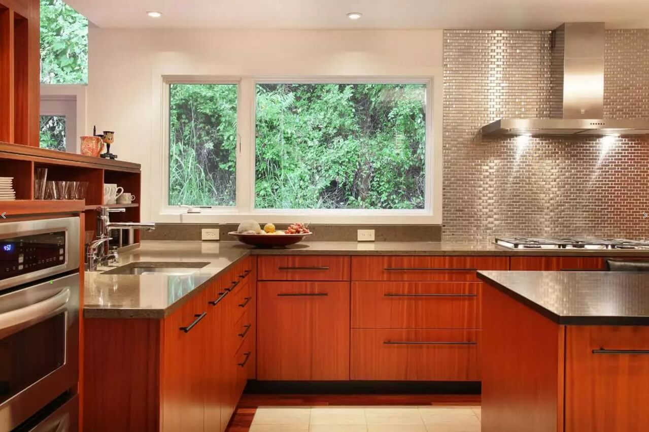 Fresh eco designed kitchen with mirroring steel surface of the backsplash