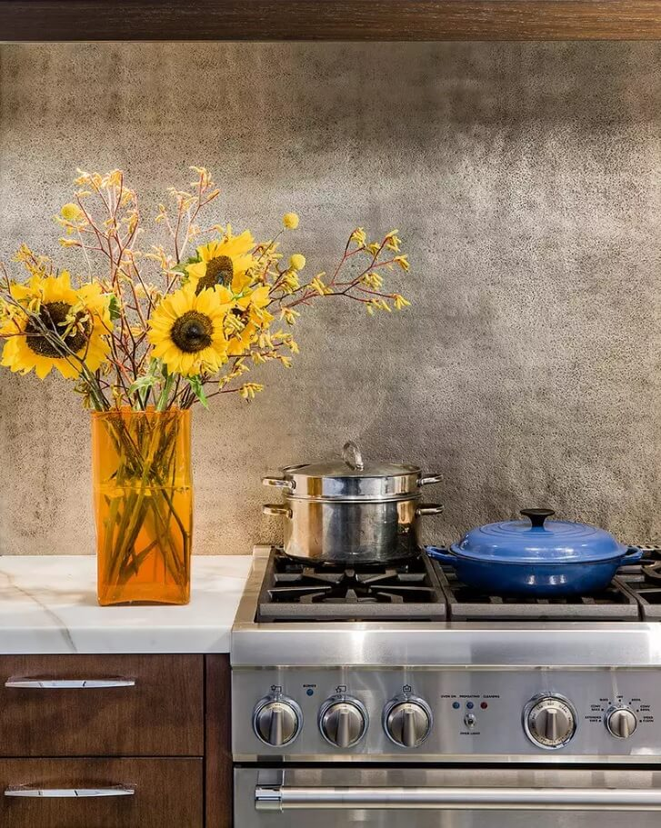 "Metal Backsplash as Stylish Design Idea for Kitchen Interior. Illustration of the nature and steel ""friendship"""