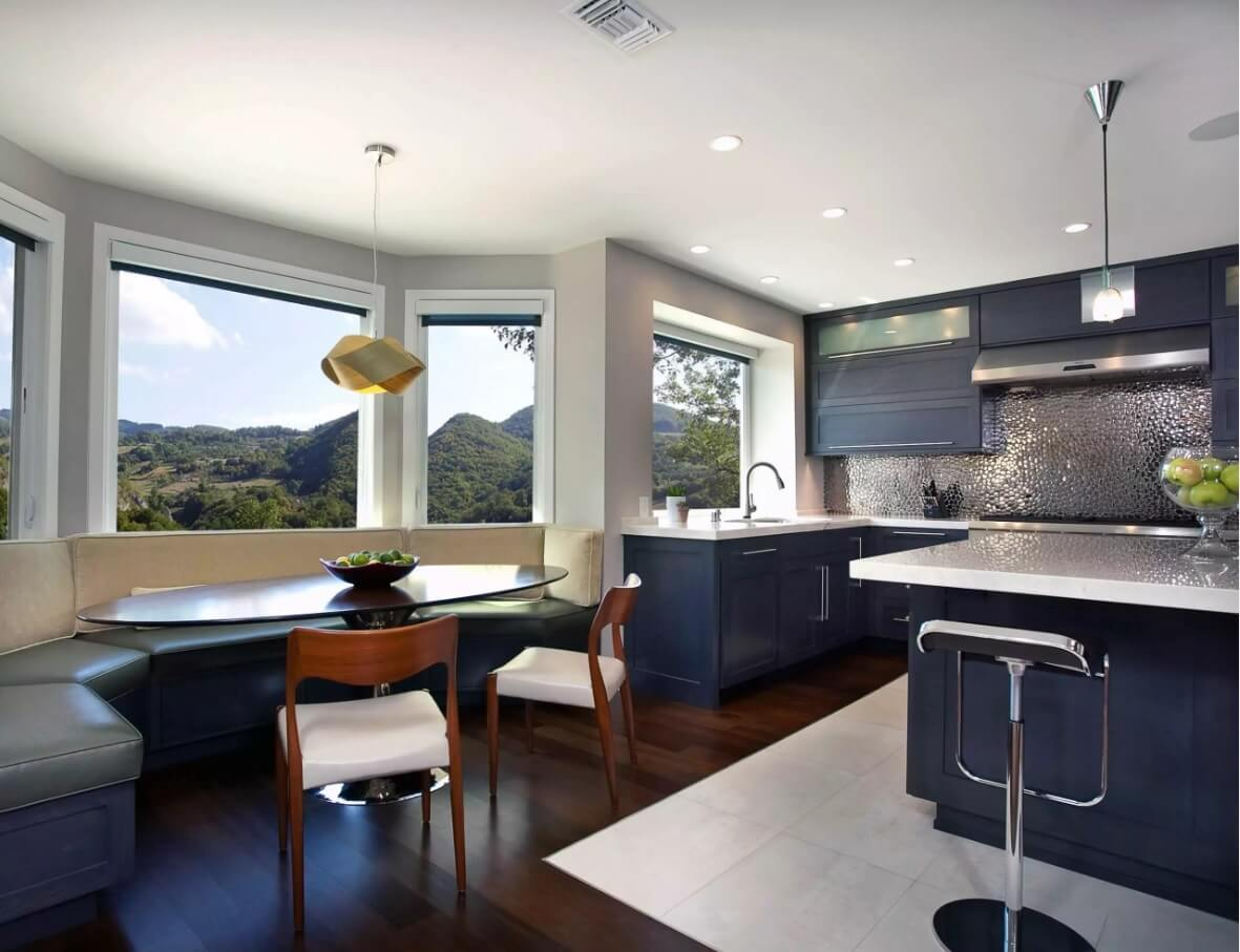 Metal Backsplash as Stylish Design Idea for Kitchen Interior. bay window room layout contributes to more light and brightness