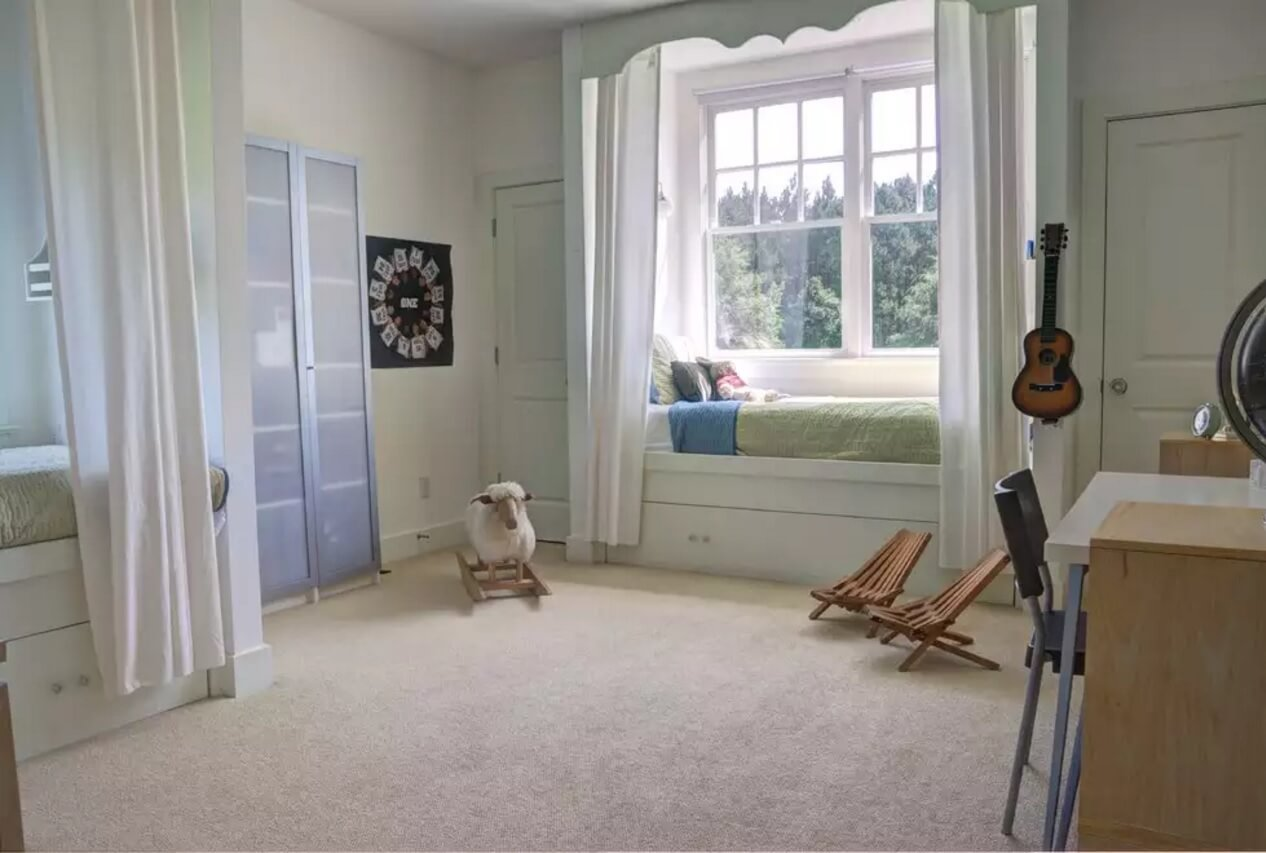 Window Sill Transformation into Uniquely Designed Cozy Additional Bed. Spacious minimalistic kids' room in light tones with bed at the window