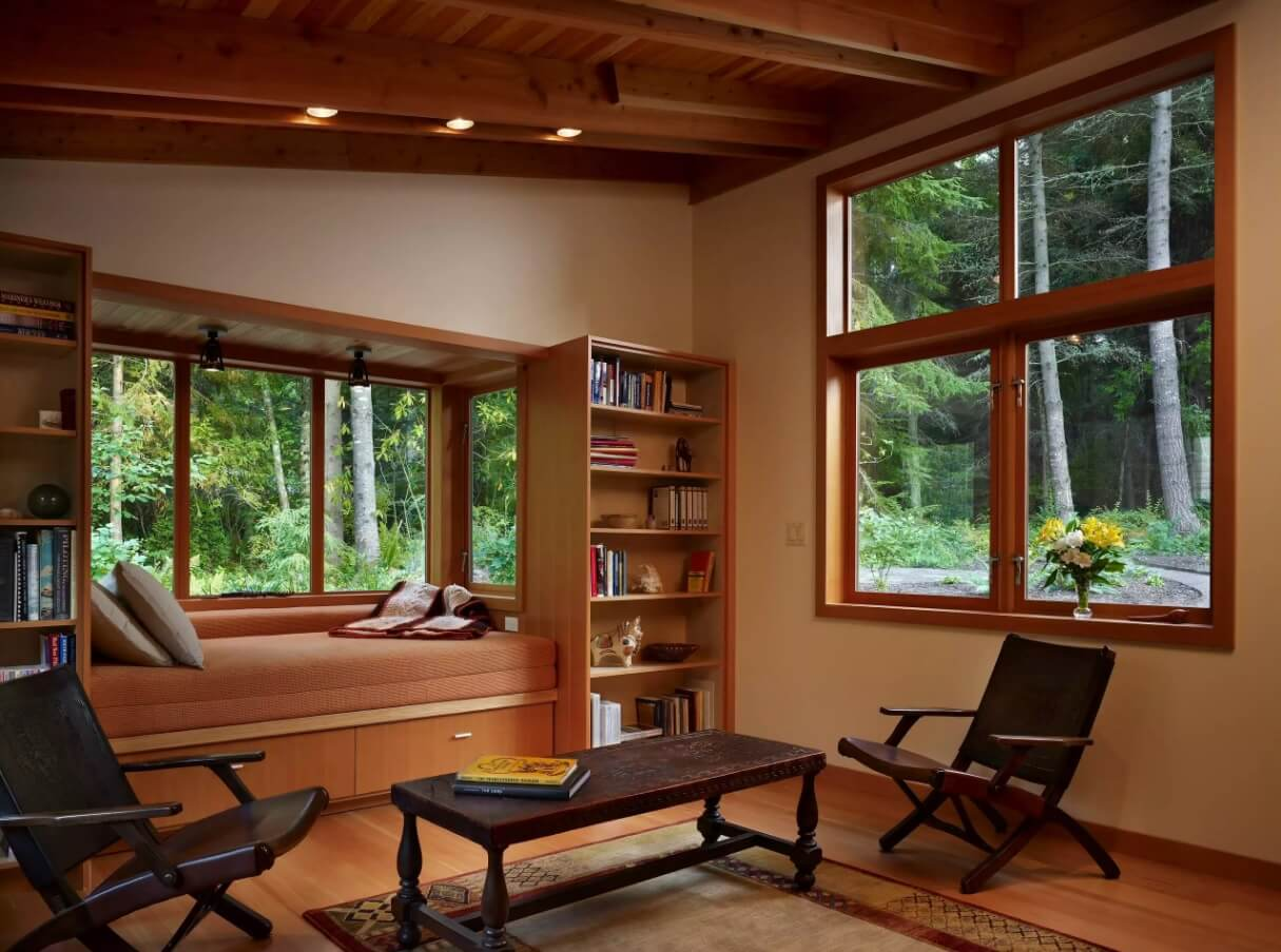 Window Sill Transformation into Uniquely Designed Cozy Additional Bed. Royal wooden trimmed room in the forest mansion