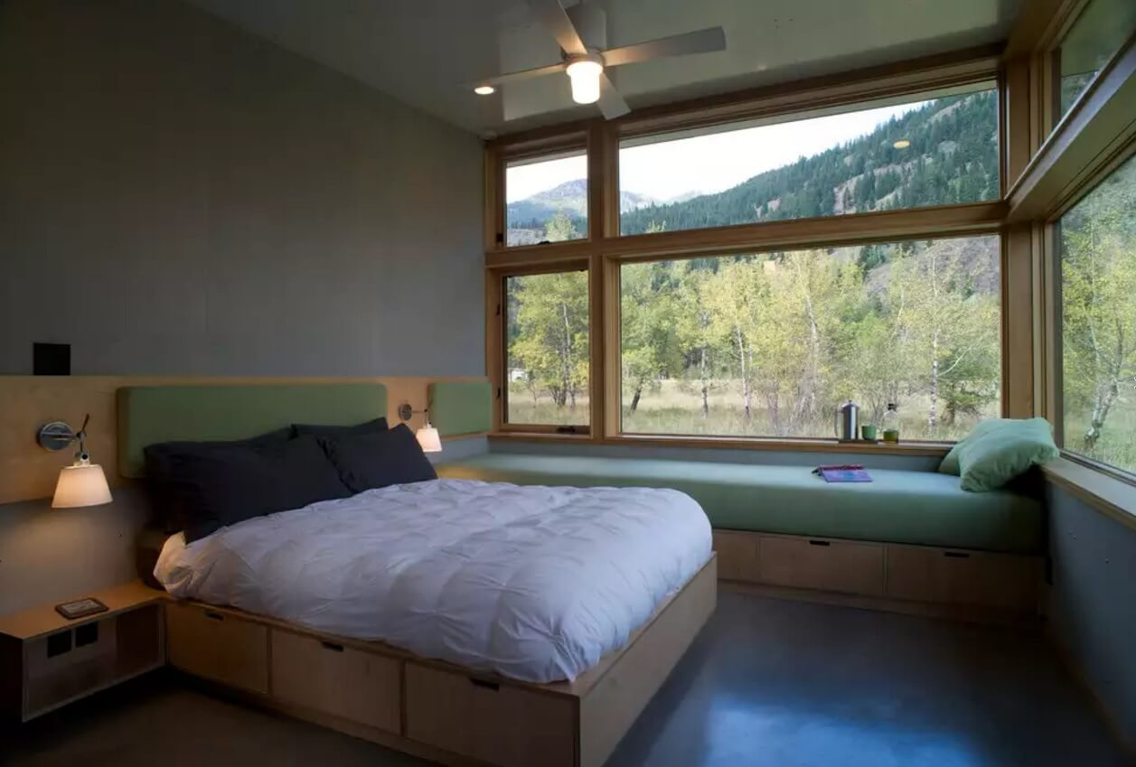 Window Sill Transformation into Uniquely Designed Cozy Additional Bed. Middle American mountain view and the cottage