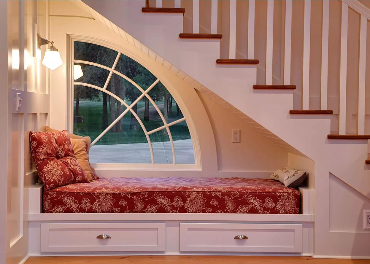 Window Sill Transformation into Uniquely Designed Cozy Additional Bed. Small sleeping place right under the stairs