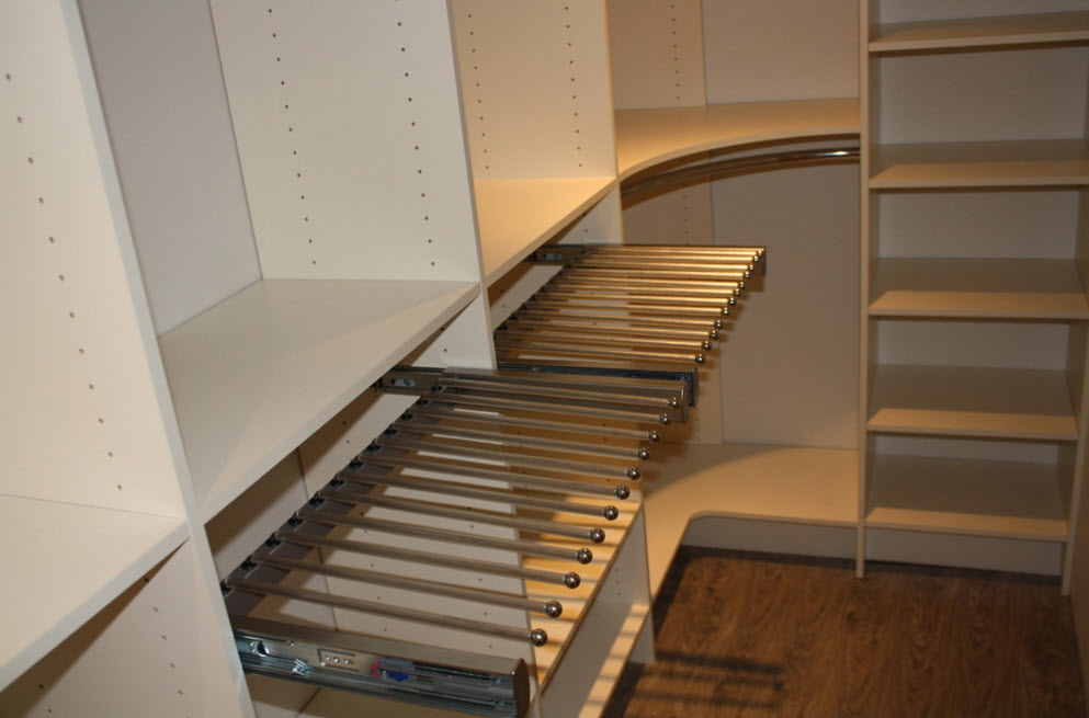 Corner Cabinet Types for Modern Bedroom Interior Design. Exposed rods to hang the clothes