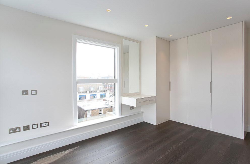 Corner Cabinet Types for Modern Bedroom Interior Design. Dark laminated floor in the white minimalistic space