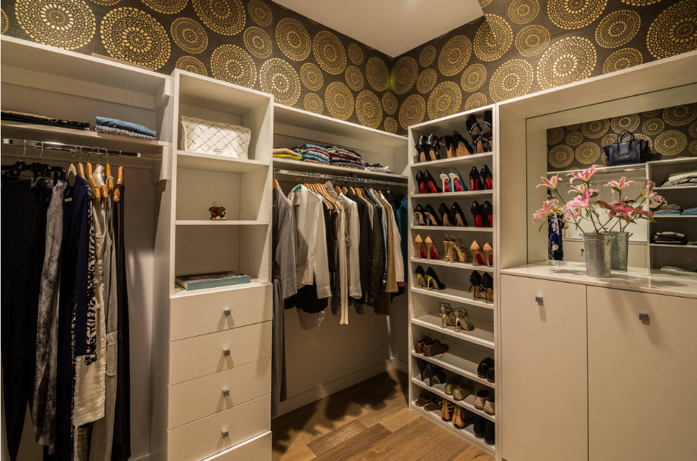 Corner Cabinet Types for Modern Bedroom Interior Design. Angular cabinet in the wardrobe finished with circle-print wallpaper