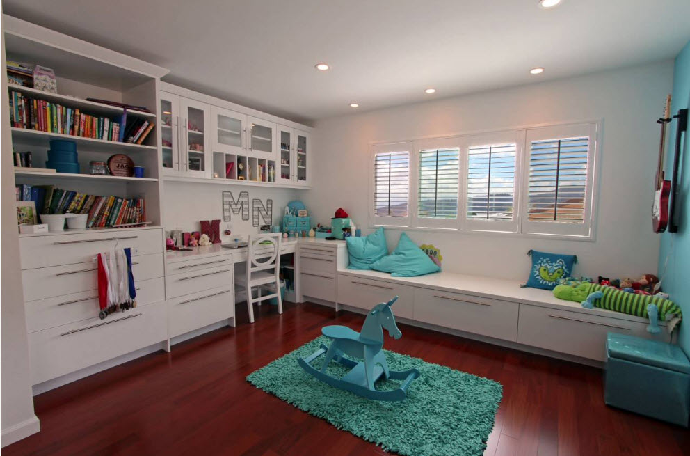 Corner Cabinet Types for Modern Bedroom Interior Design. Turquoise elements on the dark red wooden floor in the child's
