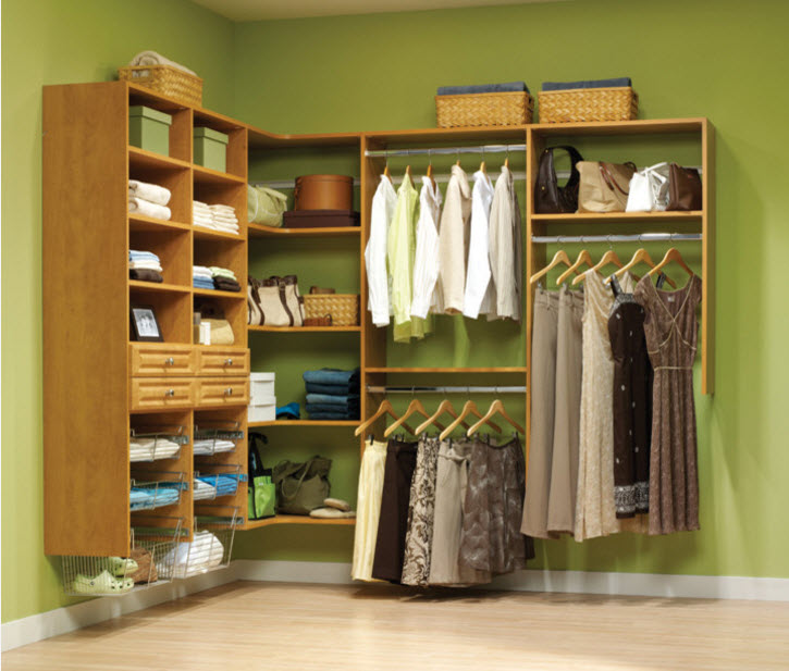 Corner Cabinet Types for Modern Bedroom Interior Design. Green wall and the open modular shelving of the wardrobe