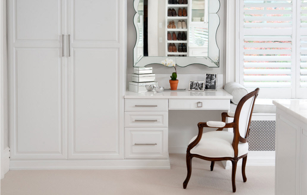 Classic white victorian boudoir design with masterfully designed storage
