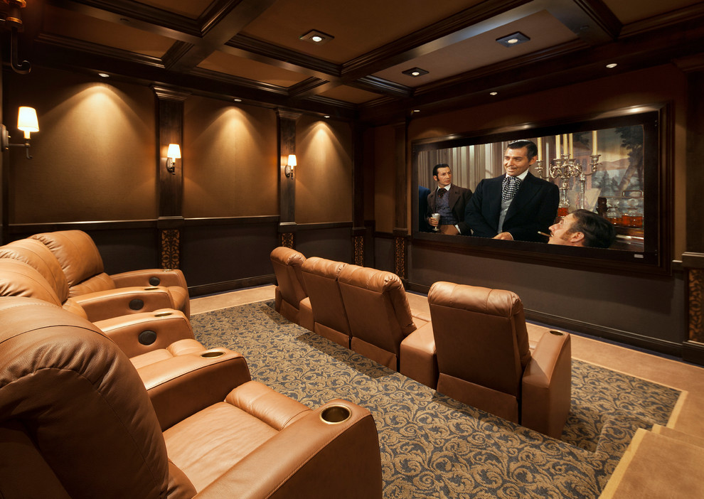 Home Theater as Addition to Large Modern Interior. A couple of seat rows in the comfortable and thought-out hall with enormous screen