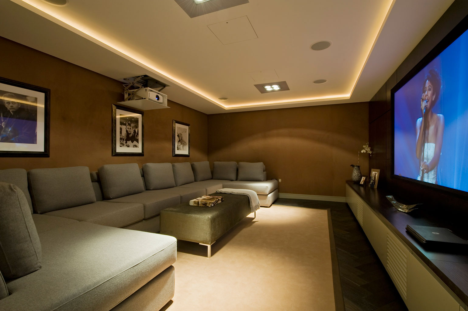 Home Theater as Addition to Large Modern Interior. Very warm and minimalistic design