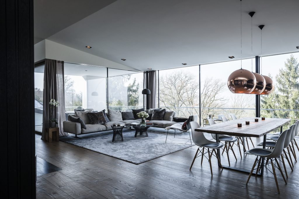 Zoning Living Room's Multiple Functional Areas with Decor and Lighting.  Sandwich looking space between the plain ceiling and floor with panoramic windows