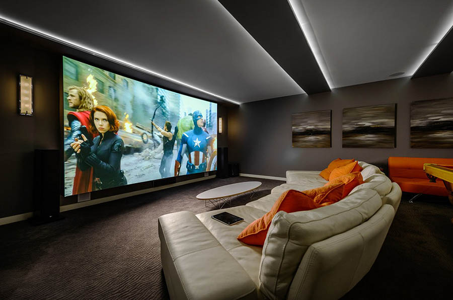 Home Theater as Addition to Large Modern Interior. All-wall sized screen creates the atmosphere of plunging into the movie
